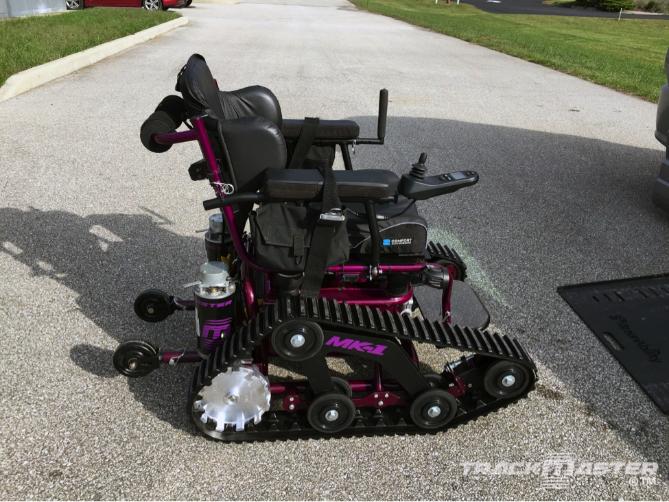 Custom TrackMaster MK-1 with lateral support seating from Comfort Companies, purple color.